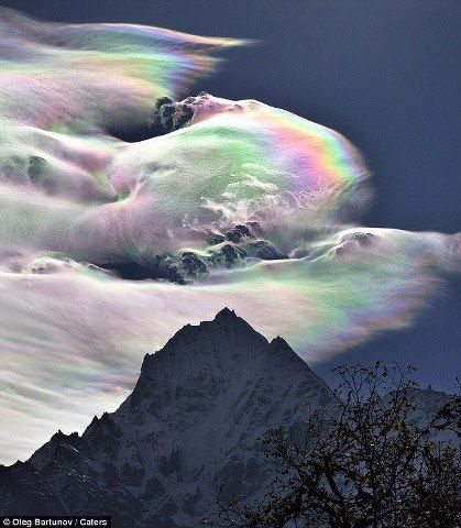 This absolutely amazing image shows a rainbow cloud above Mt Everest.  The rainbow effect is created when tiny ice crystals in the water vapour of the clouds reflect the sunlight.  The sight is rare and has only ever been photographed a couple of times.    Image credit: Oleg Bartunov  I need this for my wall.....