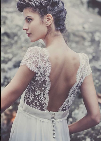 Classy and elegant! Loving the lace and button accent.