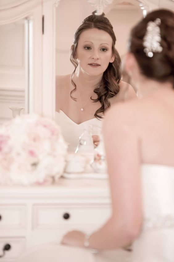 Ray Lockyer Yeovil Wedding Photographer - Bride finishing her make up during bridal preparation at Brympton House
