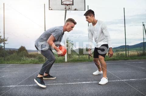 Handsome Teenage Boys Playing Basketball Outdoors On Playground Stock Photos Ad Boys Playing Handsome Teenage Boys Playing Teenage Boys Teenager