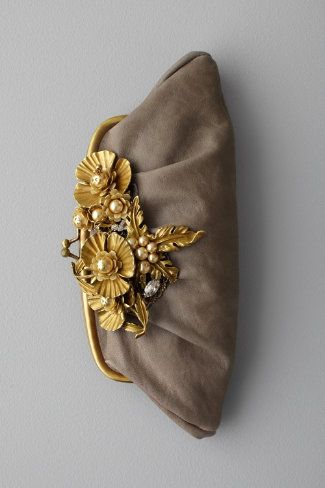 vintage clutch with metal and pearls embellishment