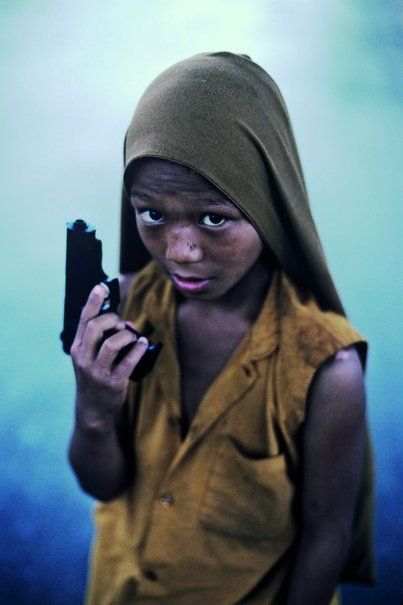 ...and you know he would use it simply by the look in his eyes.  Another world yet kids in the US are now getting this look. Thanks video games. Steve McCurry