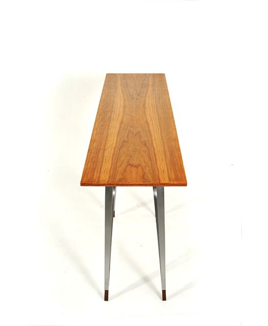 This console table features cherry bent-wood laminates with rosewood accents. The steel legs are held off from the table top and box with steel spacers. An all wood  drawer mechanism allows the drawer to be fully extended.