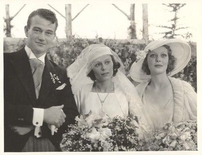 John Wayne married his first wife, Josephine Saenz, the daughter of the Panamanian Consul in Los Angeles, on June 23, 1933.  After the ceremony, the couple and guests celebrated at the home of Loretta Young (right).