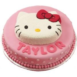 The birthday gal feels special when she spies this so-pretty kitty perched atop a 2-layer cake pedestal.