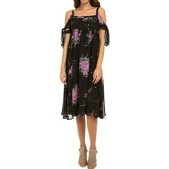 Free People Tied to You floral boho dress The fabulous Free People dress is brand new with tags!! The flowy fabric is so comfortable and the empire waist is super flattering.  It has straps and a purple floral design on a black background.  From a smoke free home :)  Color is described as midnight Free People Dresses