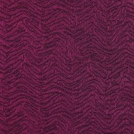 From Marc Jacobs, a lightweight silk brocade with a textured, trapunto-like effect. Soft to the touch and makes big folds, similar to a very lightly quilted fabric. The color is a gorgeous plum. We see this as jackets, close-fitting dresses, and evening wear.