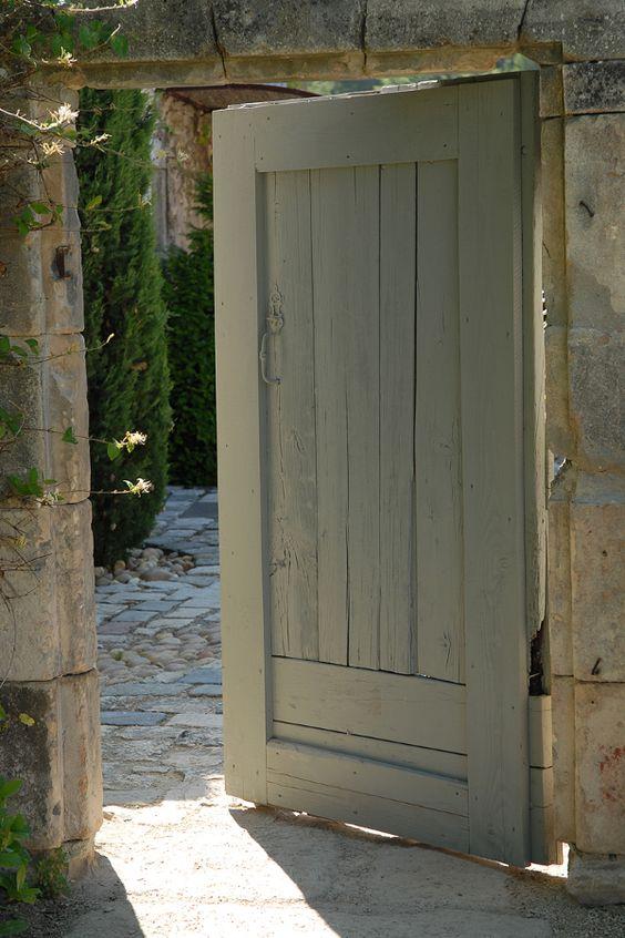 Rustic French farmhouse or bastide exterior door. #europeanfarmhouse #frenchfarmhouse #bastide #rusticdecor #door #stone