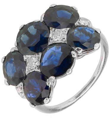 Art Deco sapphire, diamond, and platinum cocktail ring by Cartier. Made in France between 1920and 1940, this antique beauty features 8.4 carats of deep blue sapphires accented by 0.34 carats of natural round diamonds. Via Diamonds in the Library.