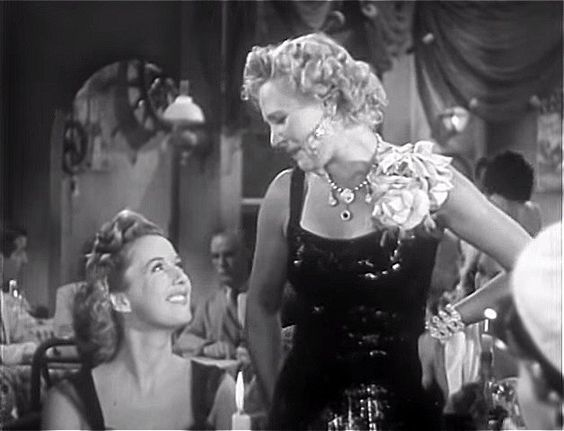 Phyllis Brooks, unidentified actress (as Marge) | Dangerous Passage (1944)