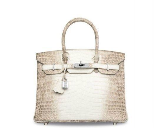 Bolsa mais cara da história é vendida por US$ 300 mil http://angorussia.com/lifestyle/moda/bolsa-cara-da-historia-vendida-us-300-mil/