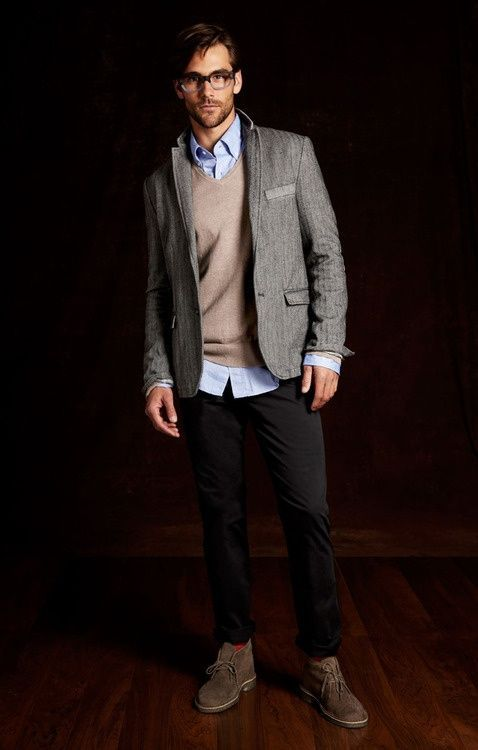 Dress in a grey wool blazer and black chinos to achieve a dressy but not too dressy look. This outfit is complemented perfectly with dark brown suede chukka boots.%0A%0AShop this look for $288:%0A%0Ahttp://lookastic.com/men/looks/longsleeve-shirt-crew-neck-sweater-blazer-chinos-socks-desert-boots/6040%0A%0A— Light Blue Longsleeve Shirt %0A— Beige Crew-neck Sweater %0A— Grey Wool Blazer %0A— Black Chinos %0A— Red Socks %0A— Dark Brown Suede Desert Boots %0A