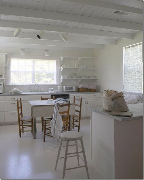 A humble white shabby chic farmhouse kitchen by rachel ashwell at her B&B #theprairie. #RachelAshwell #countrykitchen