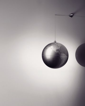 This nice globe, designed by Jakob Wagner & Louise Christ, made of plastic & metal, is suspended by a magnet and can be easily detached for contemplation.