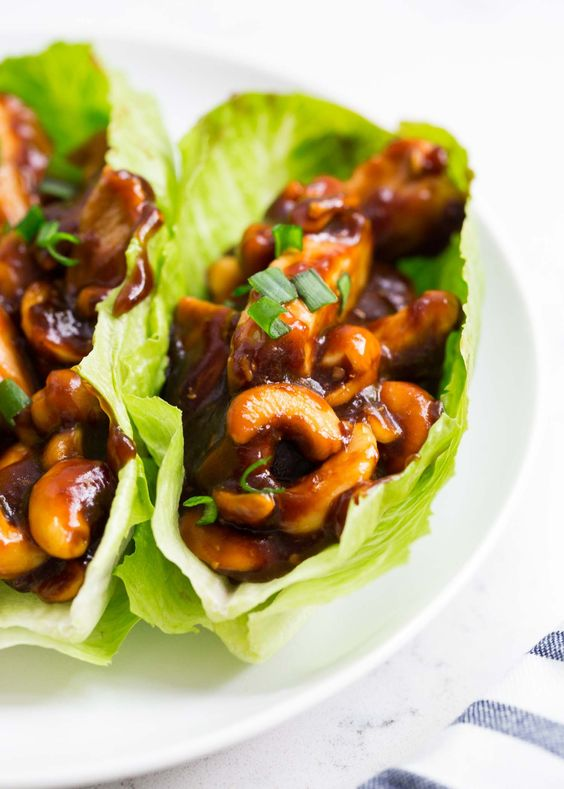 """EASY Cashew Chicken Lettuce Wraps …this delicious recipe tastes better than take out and isdone in 20 minutes. A one pot dish the whole family will love! This recipe is perfect for summer and one you need to put on your """"must try"""" list. It's one my whole family loves and a dishmy husband and …"""