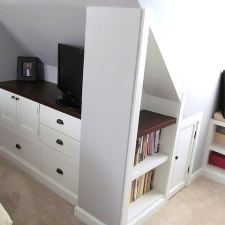 Repurposed dressers, doors and drawers, cut down to size, create handy storage under the eaved walls in this attic bedroom. | thisoldhouse.com/yourTOH