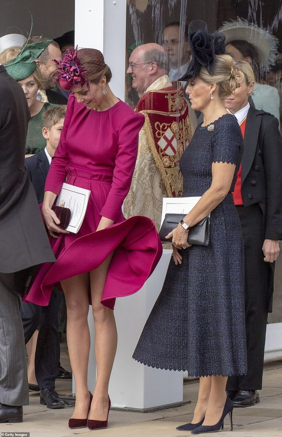 The Countess of Wessex watched it happen and pursed her lips in fear as Kate caught her flyaway skirt before it went too far
