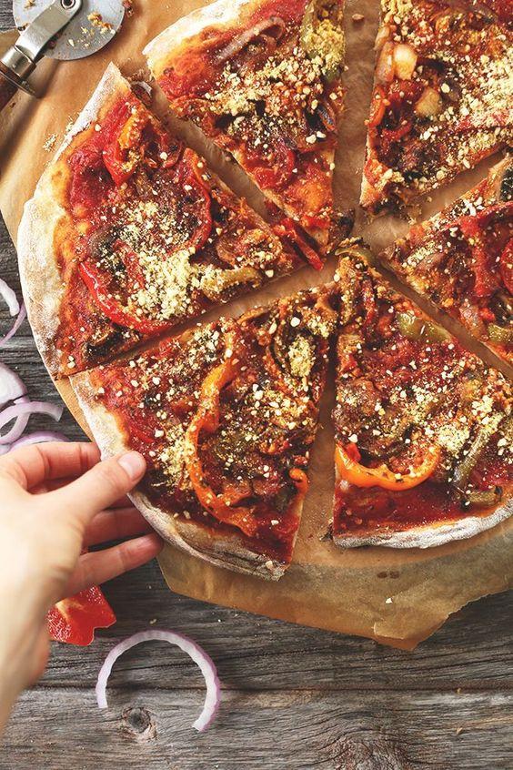 THEE BEST Vegan Pizza! Sauteed veggies, simple tomato sauce, loads of #vegan parmesan cheese. Pizza perfection!