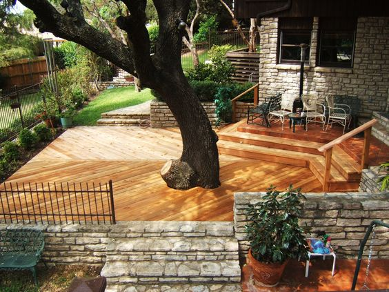 Deck Built to Incorporate Live Oak Tree Into Home's Modern Design. In the middle of this Austin, Texas lot stands a live oak tree. Instead of tearing it down, designers decided to incorporate it into the design of the house, allowing it to be a focal point for the construction of this home.