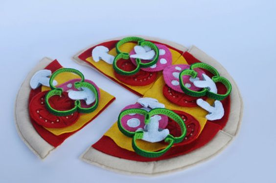 This is a handmade toy pizza. Its made entirely out of felt. This toy will make your child feel like a chef. It comes complete with all the toppings