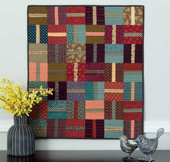 How so you add wow to a quilt made with super-simple-to-stitch blocks? Amp up the texture with rich prints; then quilt closely spaced parallel lines from side to side.:
