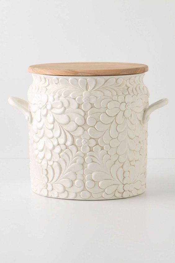 I have a love for canisters, this one is a bread bin and the lid can be used for a cutting board