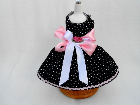 This adorable black and white polka dot dress is completely lined for your special pet. Adorned with wide pink and white satin bow. 30.00
