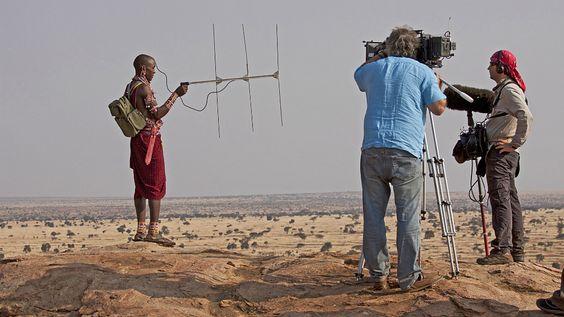 Maasai warrior I. Oulbi radio-tracking lions in Kenya, Africa.