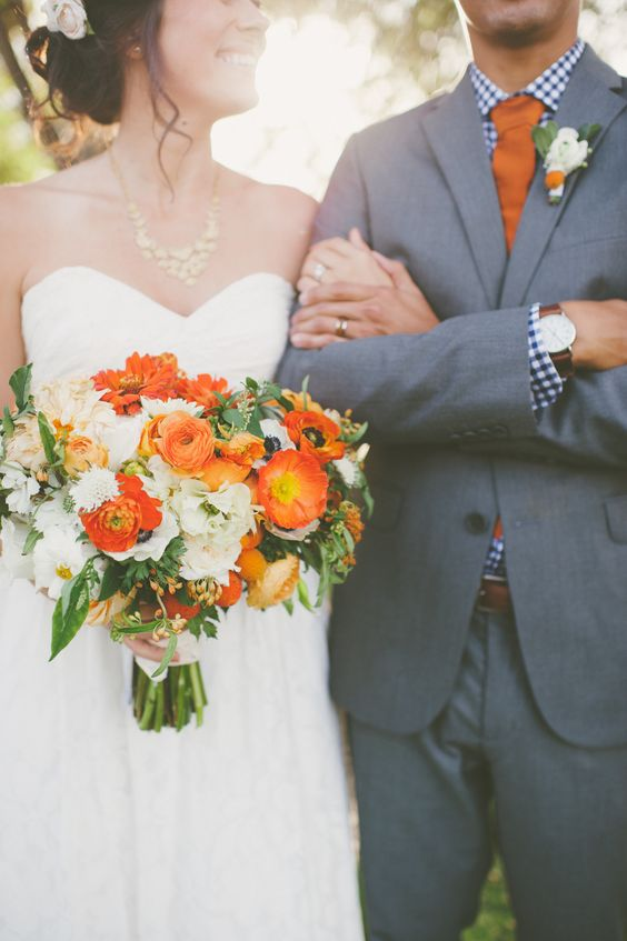 Bold wedding flowers + contrasting gingham shirt = chic.   Photography: Eden Day Photography - www.edendayphotography.com  Read More: http://www.stylemepretty.com/california-weddings/2014/06/09/bold-autumn-backyard-wedding/