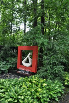 Garden ornaments and landscape sculpture pieces can add interest to your yard.  This modernistic figure tucked into a painted frame is an unexpected sight among the trees and hosta - what a great accent for a shady area!  We specialize in unique MN #LandscapeDesign - http://www.aldmn.com