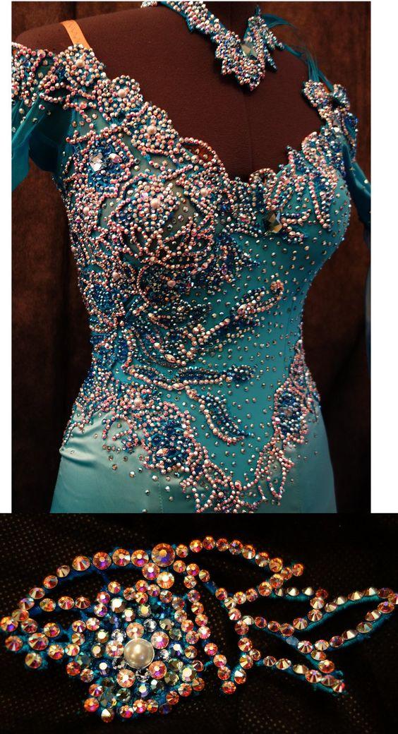 Intricate rhinestone work on teal fabric