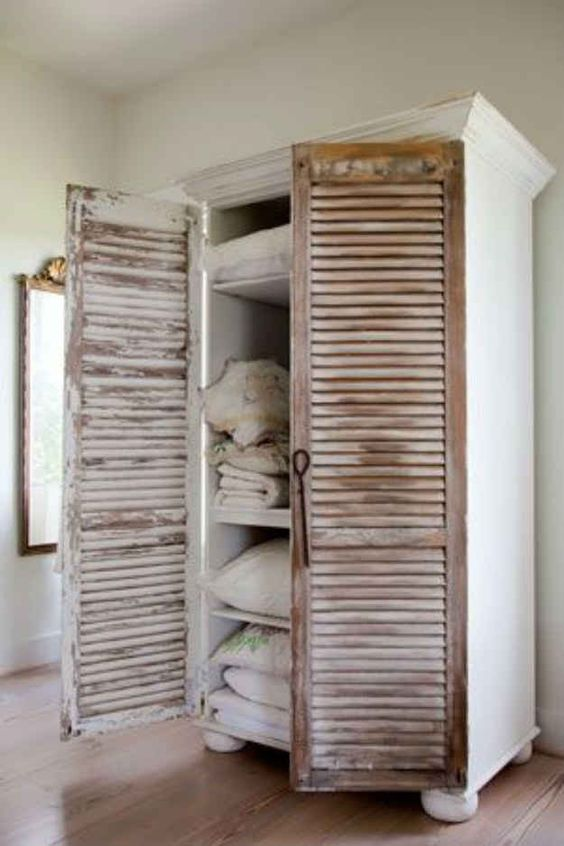 Add vintage shutters to a bookcase | 25 Cheap And Easy DIYs That Will Vastly Improve Your Home - Actually pinning for the aesthetic, function is just the cherry on top.