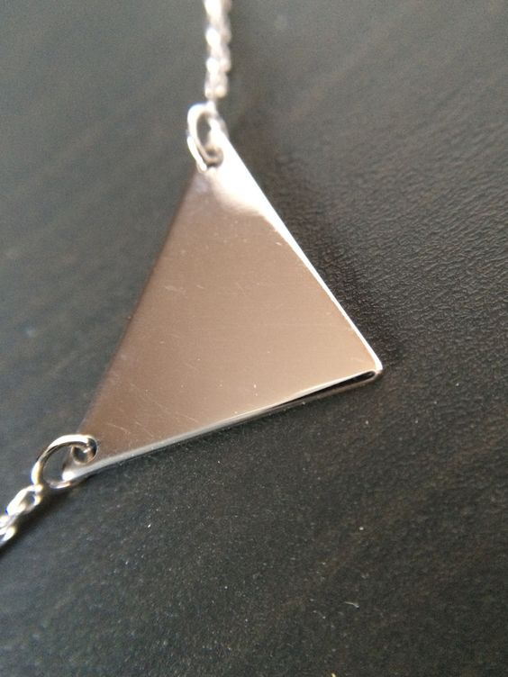 Small Sterling Silver Triangle Necklace. - Purchase helps sponsor the education of 6 kids in Rwanda!  How beautiful all around!