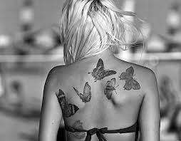 blake lively tattoo...this is from a movie she was in...think i want something similar to this...butterflies in a flight path in different stages of flight...