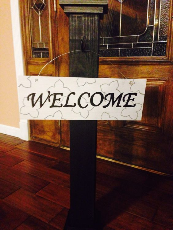 Thanks to my cool sister-in-law for making us this wonderful sign post for the front porch!