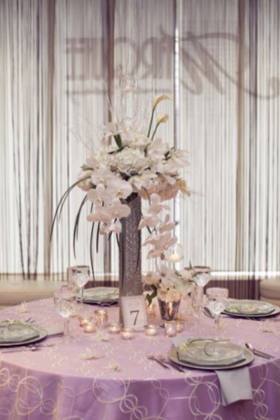 Marquee in Hartford, Gatsby Shoot. Dripping with Phaleanopsis Orchids, Calla lilies, hydrangea, Iris, monkey grass and birch twigs holding hanging glass balls with votives inside for a glimmering touch.  By: Azalea Floral Design in Plainville CT