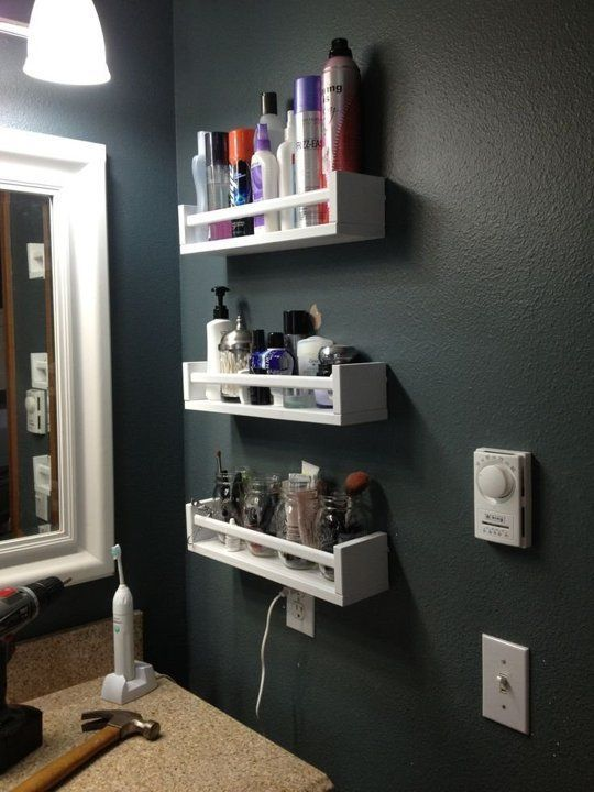 Hang spice racks (like the IKEA BEKVAM shown here) on the wall to organize makeup. Image from Serena Kelley.: