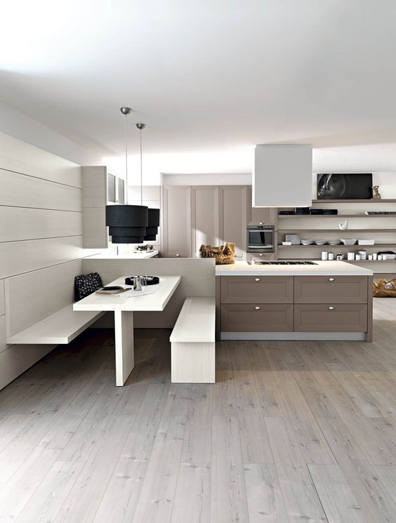 Un tavolo una panca sospesa e una panca la cucina ritaglia uno spazio dedicato allo stare - Panca e tavolo cucina ...