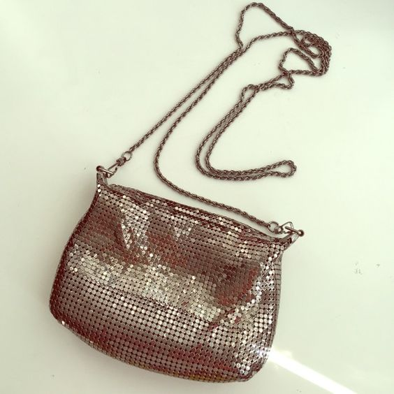 Metallic Silver Chain Small Elegant Bag Excellent condition metallic silver soft chain small bag with long chain shoulder strap. Main zipper closure and no stains. Great evening bag for a elegant night out. Bags