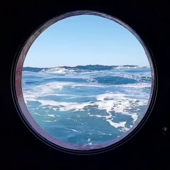 This view through a surface level porthole on a cruise ship makes it look like you're going into another dimension. - 9GAG