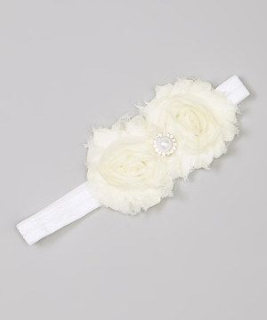 Fancy little fairies don't need a wand to spread joy and laughter wherever they go—just this charming headband blooming with sweet rosettes. A comfy elastic band keeps everything magically in place.