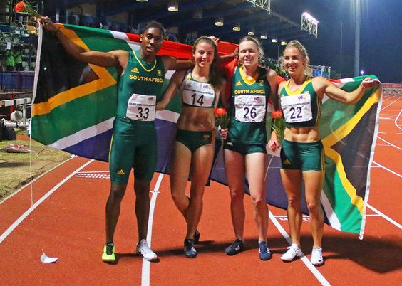 Caster Semenya and team South Africa hold a national flag as they win the 4-by-400-meter finals for women at the Confederation of African Athletics Championships in Durban on June 26.