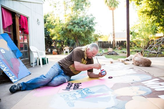 Protest artist Rob McElwain paints an Arpaio's Last Supper poster in the backyard of Salvador Reza in December 2014. Perhaps if Joe Isn't re-elected he would calm down.