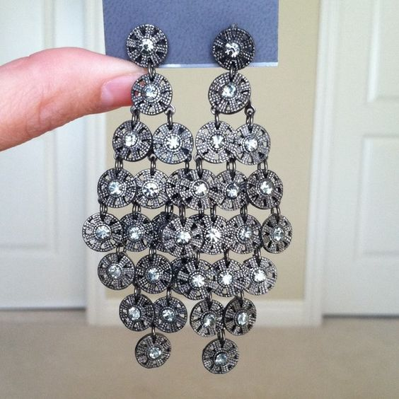 Chandelier rhinestone earrings From Express.  I loved these when I bought them, but never wear them because they are dark & blend in with my hair (which is also dark).  Someone else needs to enjoy these :) Express Jewelry Earrings