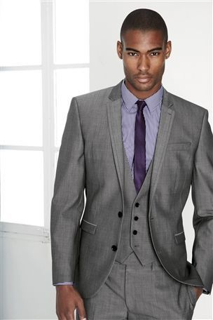 Three Piece Gray Suit With A Slim Purple Tie Maybe During