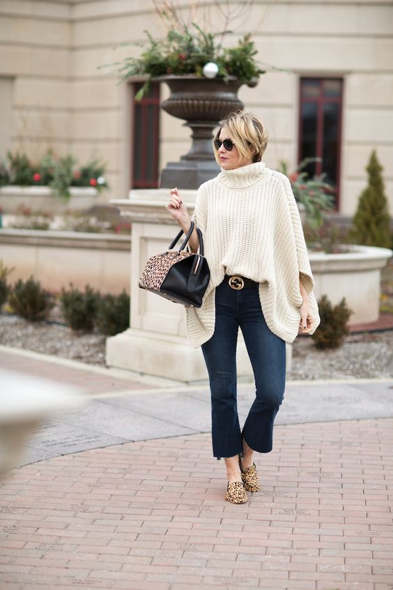 Seersucker and Saddles. White knit poncho+flare cropped jeans+leopard print loafers+black belt with golden details+black and leopard print handbag+sunglasses. Fall Casual Outfit 2016: