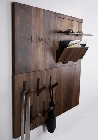 Hallway Organization. UtiliTILE from Thout Design. Different tiles are responsible for different function from a row of hooks to key and shoe storage... And can be folding flat when storage is not in use.