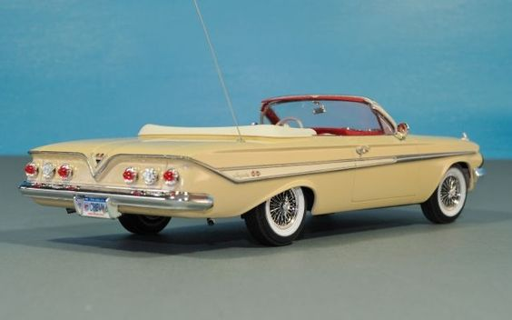 1961 Chevrolet Impala Convertible. One family that I baby sat for at their country club had a red Impala with white seats. I loved that they would drive with the top down. We had to sit on our towels on the way back home as the seats were too hot.