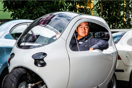 Lit Motors Founder Daniel Kim sits in his C-1, a prototype for an enclosed electric motorcycle. (Eric Millette for Forbes)