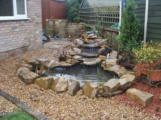 Impressive small rocky waterfall for sensational garden for Garden pond fountain design